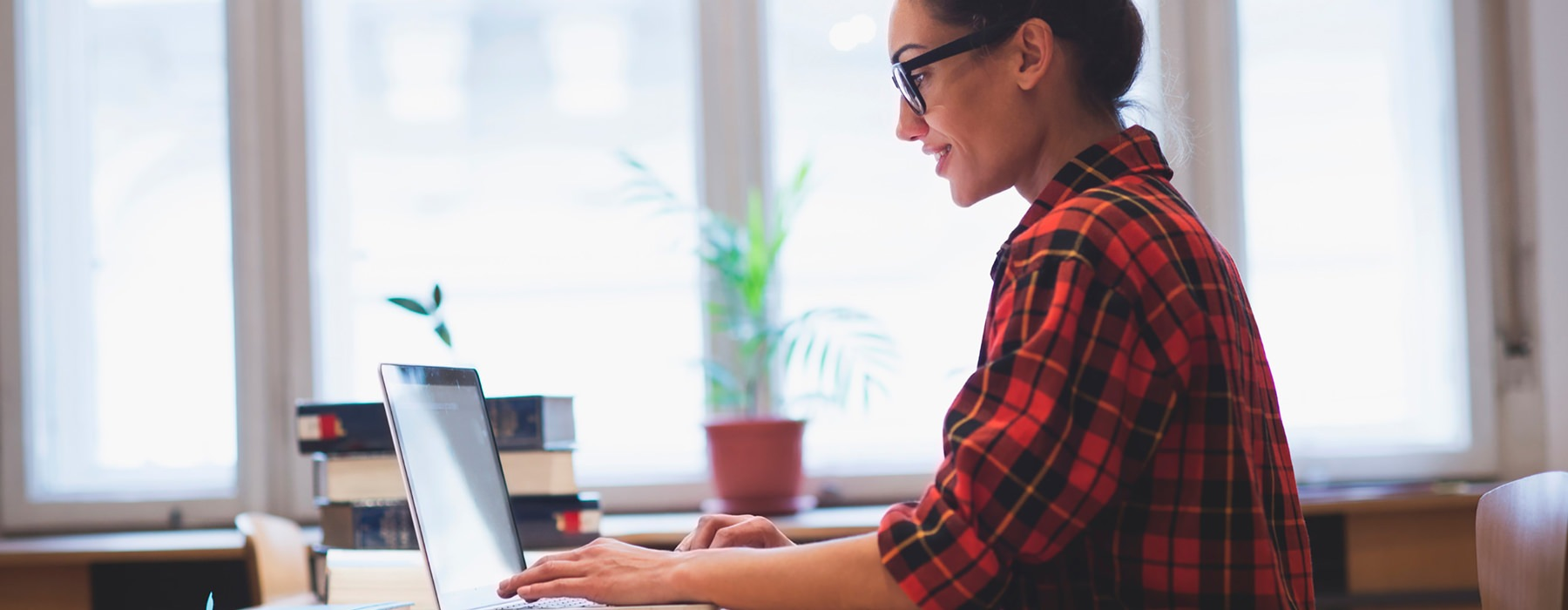 stock image of woman on laptop